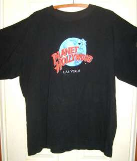 Ashanti at planet hollywood shoulder length curly for Planet hollywood t shirt