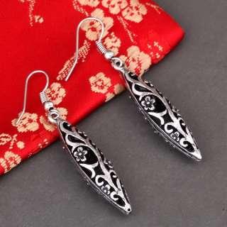 Olive oval tibetan silver stick flower dangle earrings