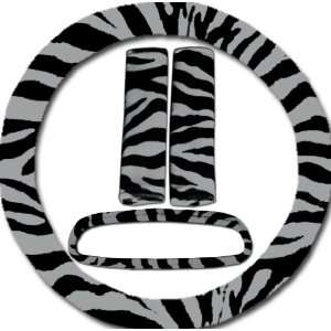 Silver and black zebra steering wheel cover, seat belt covers and rear