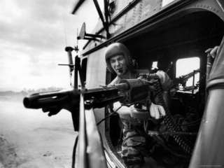 Helicopter Crew Chief James Farley Using M 60 Machine Gun in Landing