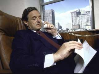 Investment Banker George Soros Working on Phone in Office Photographic